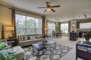 Three Bedroom Apartments for rent in San Antonio, TX - Model Living Room, Dining Room & Kitchen