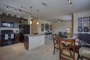 Three Bedroom Apartments for rent in San Antonio, TX - Model Living Room, Ktchen and Dining Room